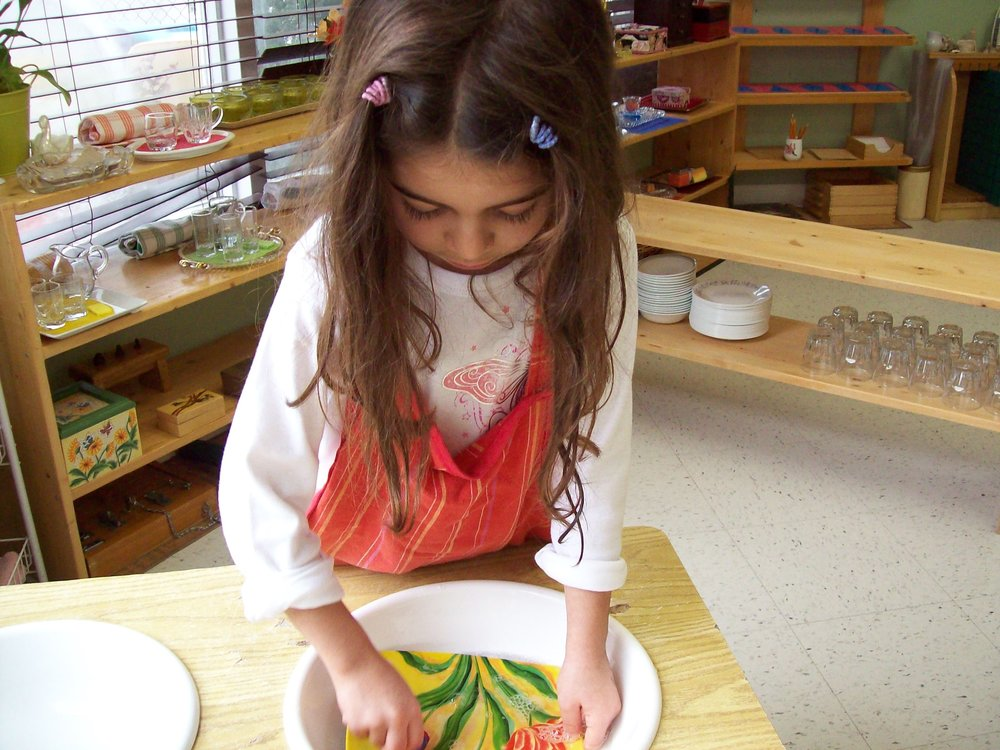 Child painting in class at Kaban Montessori in Mississauga.
