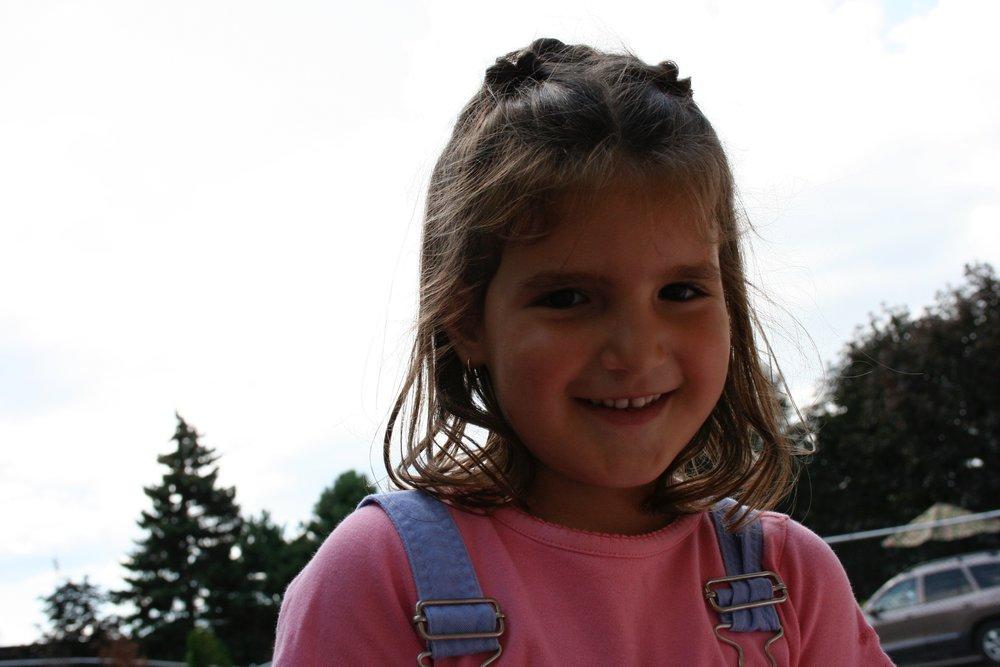 Todler smiling outside at Kaban Montessori in Mississauga.