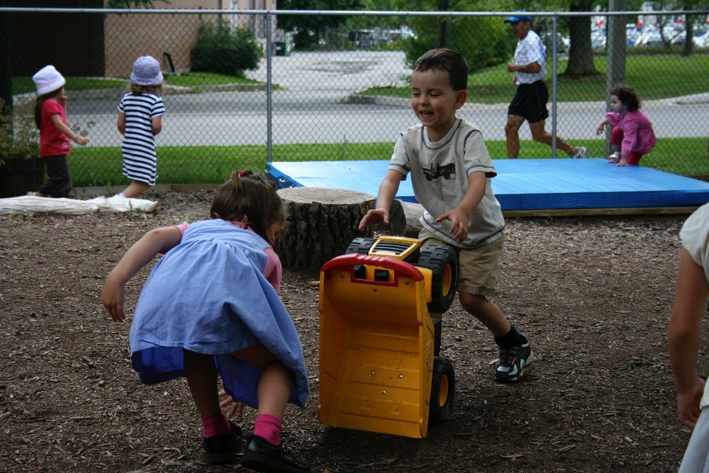 Children enjoying the summer day in the playground at Kaban Montessori in Mississauga.