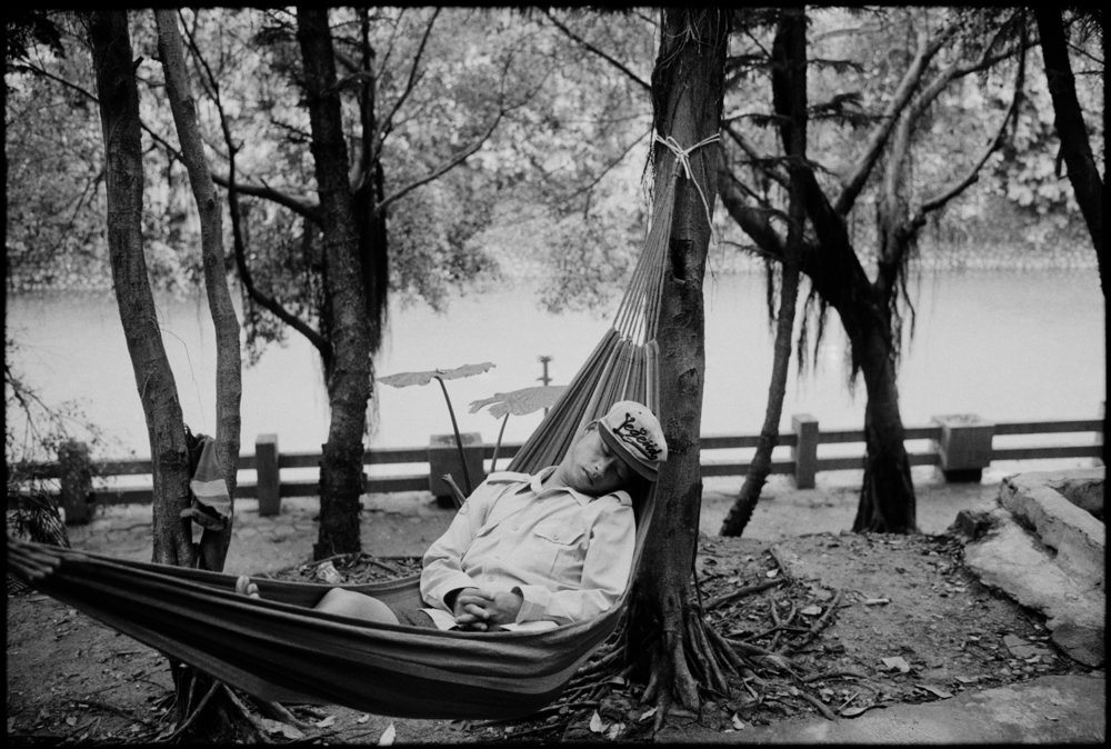 asleep in hammock Nanning.jpg