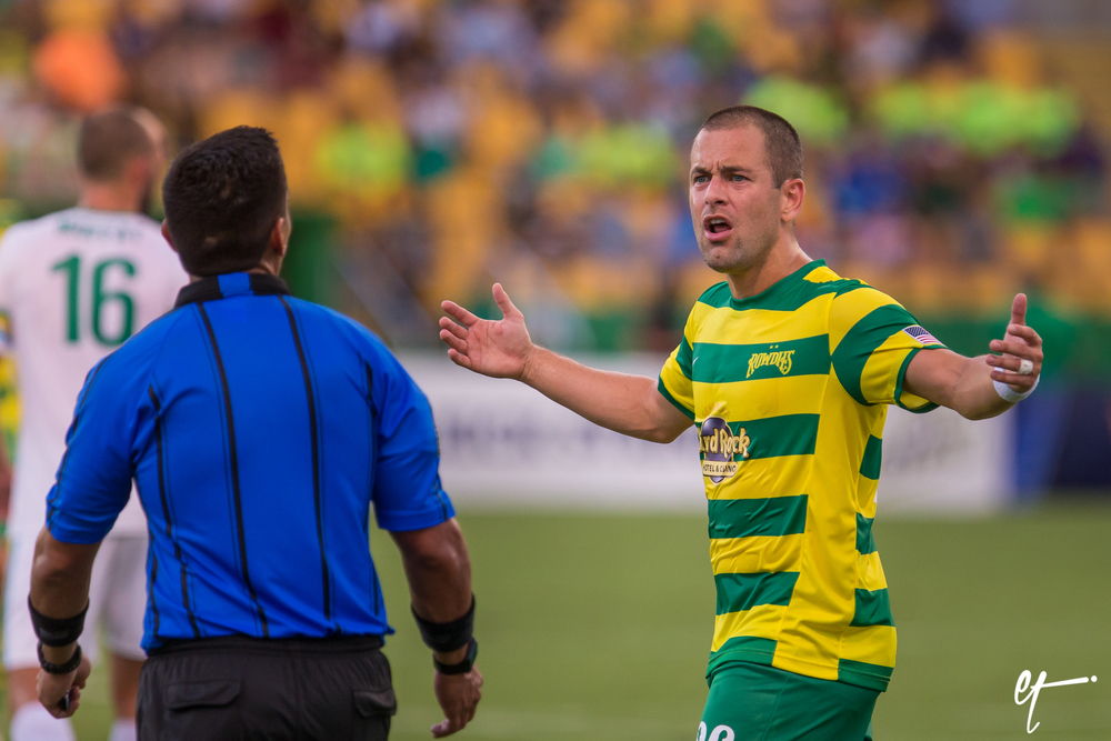 Joe Cole (Rowdies) argues with a game official after being called offsides on a breakaway play in the first half. © Eric Tillotson