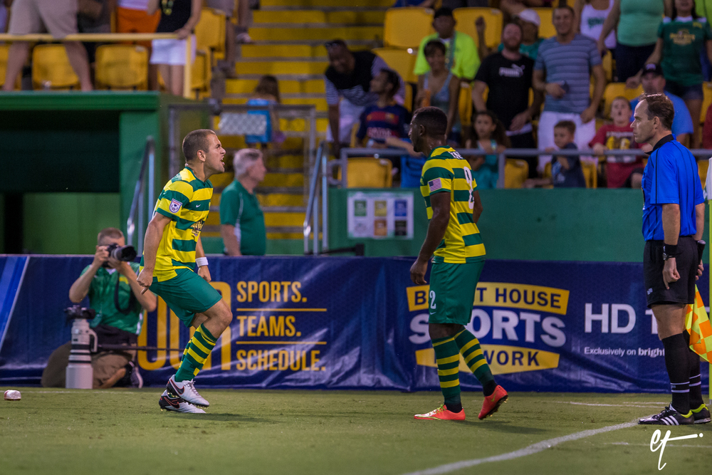 Tampa Bay Rowdies Joe Cole and Darnell King argue with the linesman on the handball call to reverse the Rowdie's goal. © Eric Tillotson