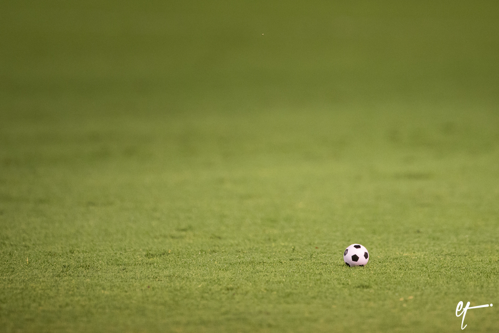 One of many mini soccer balls thrown on the field and at the referees by the fans. © Eric Tillotson