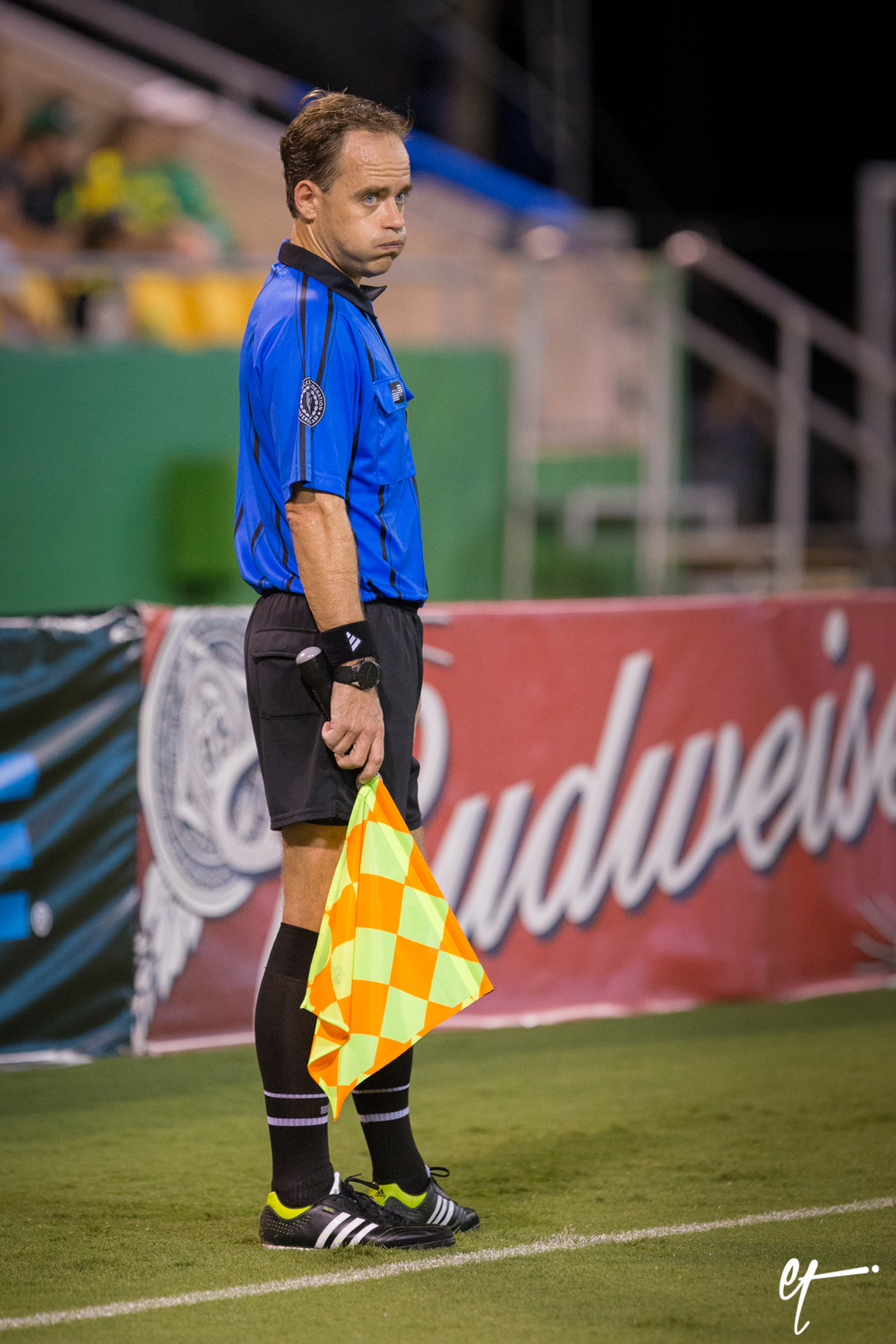 Linesman that made several tough (bad) calls trying to filter out the boos from the crowd. © Eric Tillotson