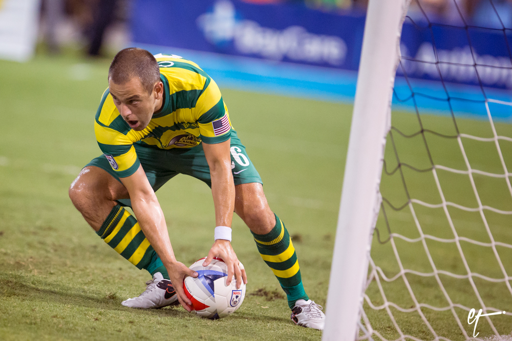 Joe Cole picks up his goal ball after scoring in the 95th minute. © Eric Tillotson