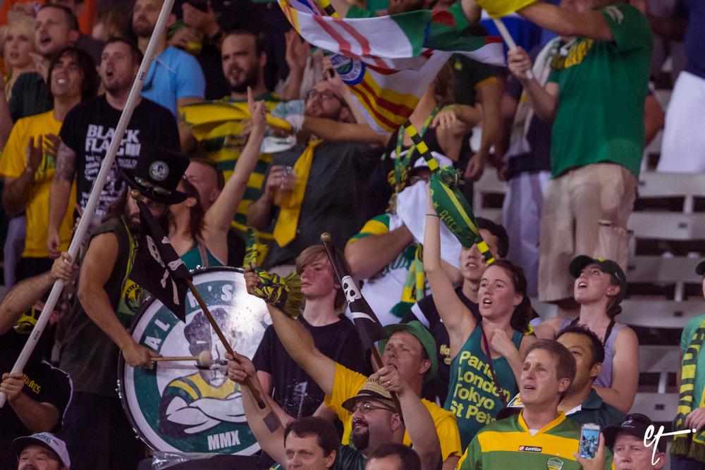 Ralph's Mob and fans react to Joe Cole's penalty kick goal. © Eric Tillotson