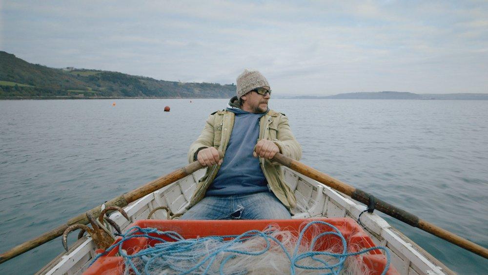 Row, Row, Row  Leo shooting a net in Cawsand Bay.