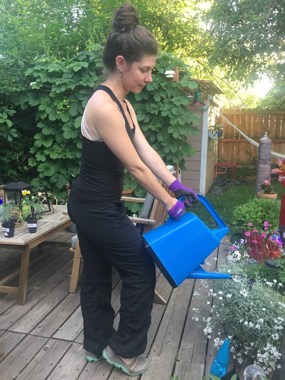 - When using a watering can, start pouring the water out by bracing it against a knee or thigh to support the weight of the watering can in a position that won't pull on the neck or lower back.