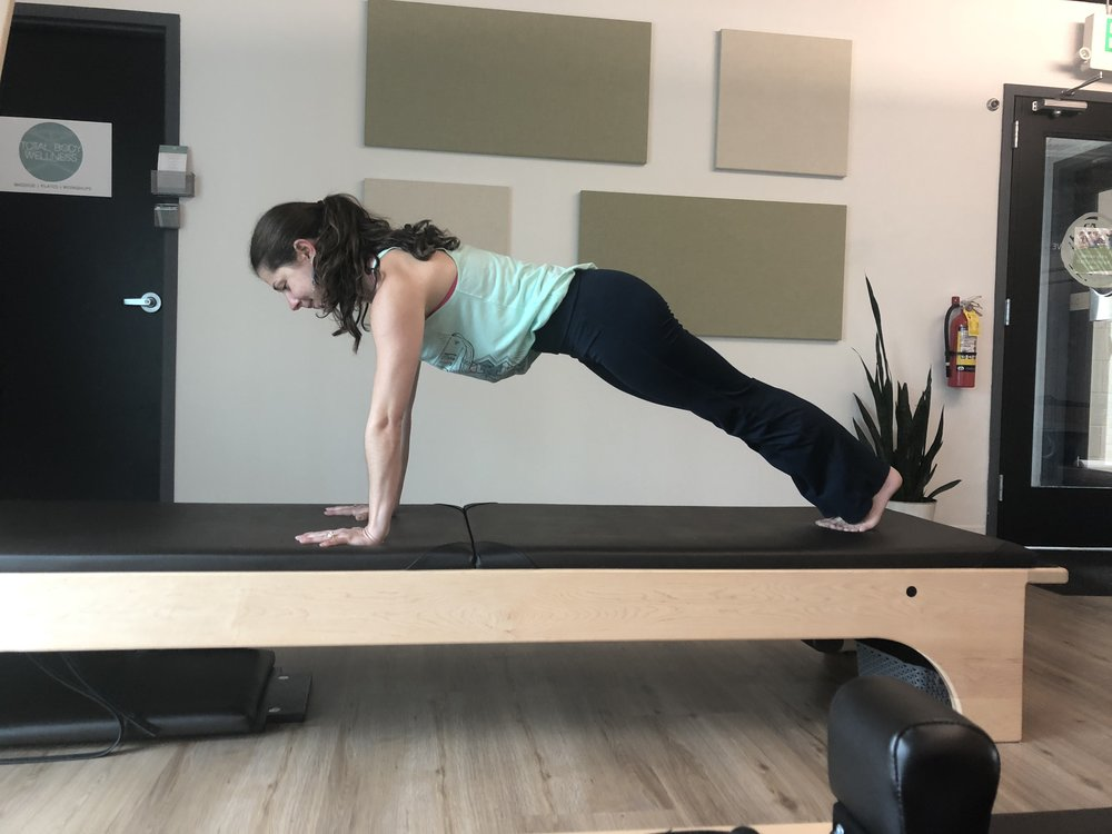 Plank - From your cat/cow position, extend your legs behind you. (You can either stay on your palms or lower onto your forearms if your wrists need a break.) Engage your legs, pulling your quadriceps away from your kneecaps. Keep some space between your shoulder blades while simultaneously lengthening your sternum forward. Hold for 5 breaths, take a break, then hold for 5 more.