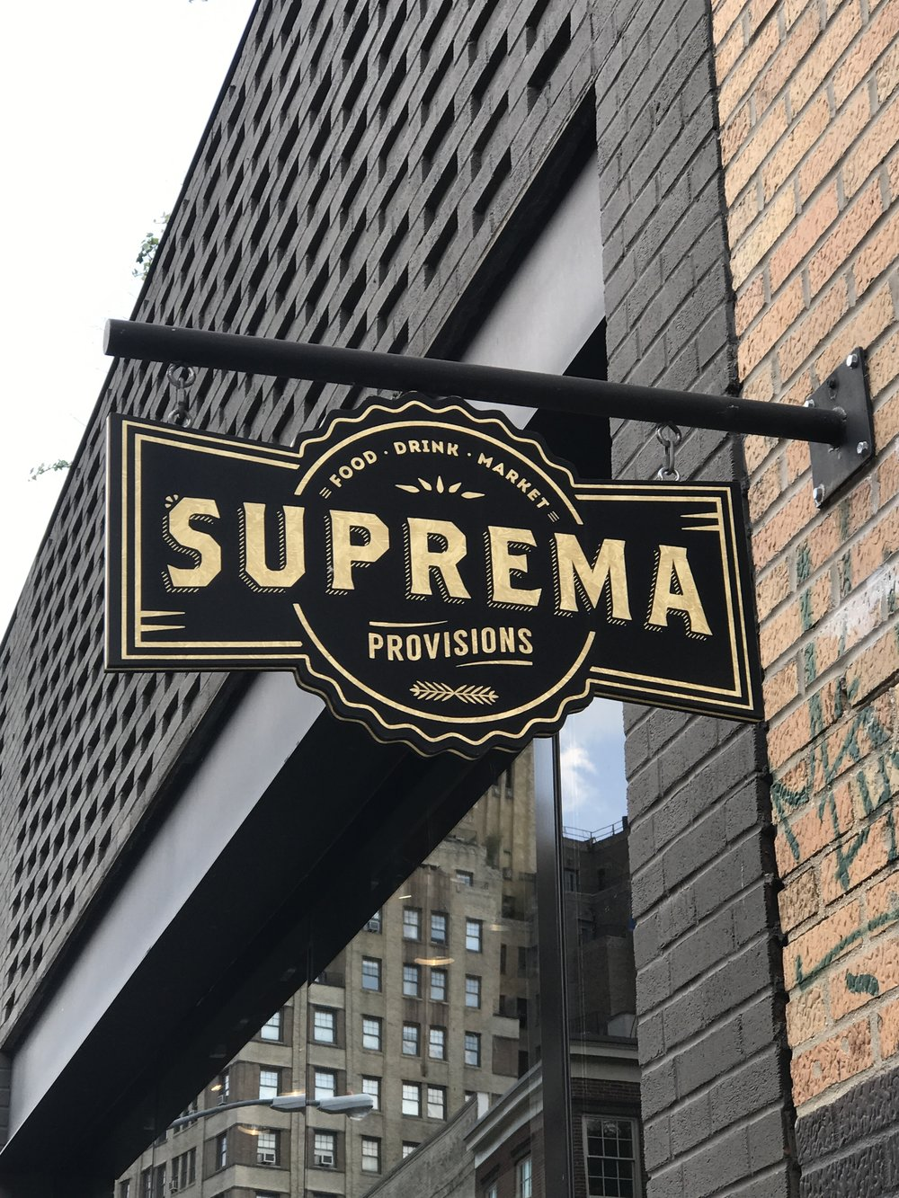 I LOVE the logo and signage for  Suprema Provisions , I saw a few of these throughout the city.
