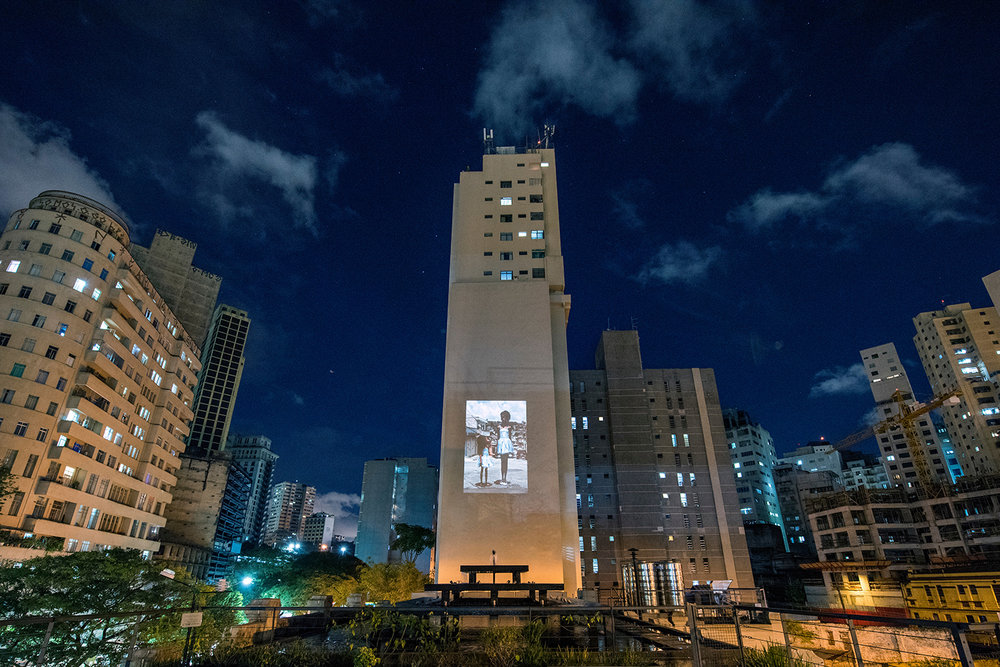 Co-curator of Foto Invasão, a photo festival with installations, projections, collective exhibition, debates, workshops, prints fair | Red Bull Station, São Paulo, 2016 and 2018. Projection in the external area, photo Ignacio Aronovich