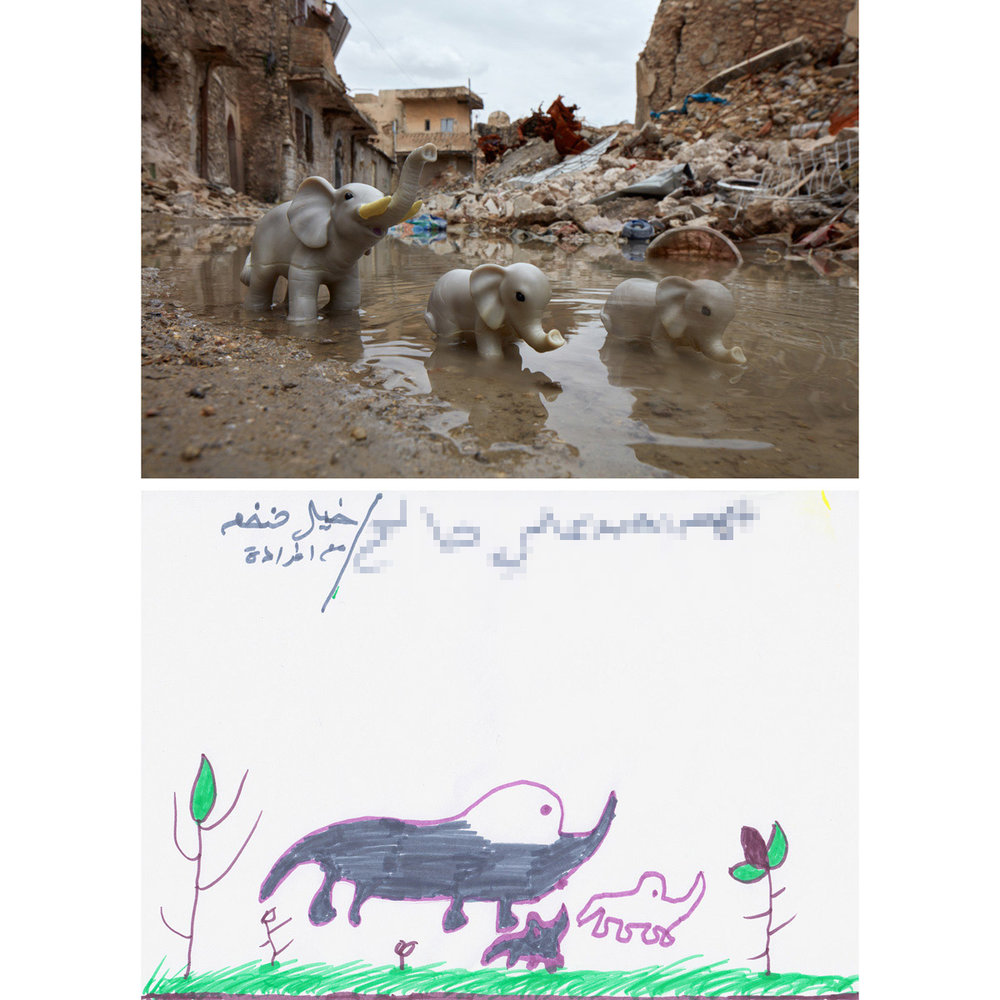 "Elephants - West Mosul, Iraq2018Ahmad made a drawing he labeled as ""a huge elephant and its [family] members"" during an art-based interview with Myra Saad inside the Debaga IDP camp in Iraq. When Myra spoke with him about it, she asked about the one elephant that only had an outline. He said very intently that he didn't want to color that one in. It was the ghost of a dead sibling, gone but still felt. The toy elephants were photographed in Mosul at the base of the al-Hadba' ("