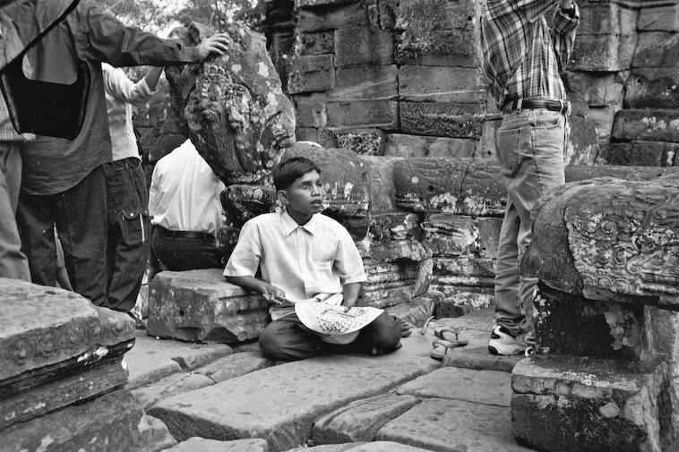 Temple beggar in Cambodia, This heartbreaking image encapsulates a growing industry of enslaved temple children in Cambodia. Image taken in 2001, courtesy of SKY