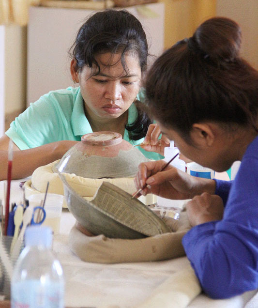 Here, Ms. Chum Sovan Mealea and Ms. Sambo Sophea are working on the restoration of Celadon ware. Photo courtesy of Tep Sokha.