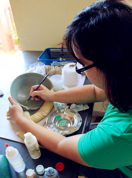 Meet Eva, training to restore the Celadon ware from Koh Sdech shipwreck. Photo courtesy of Tep Sokha.