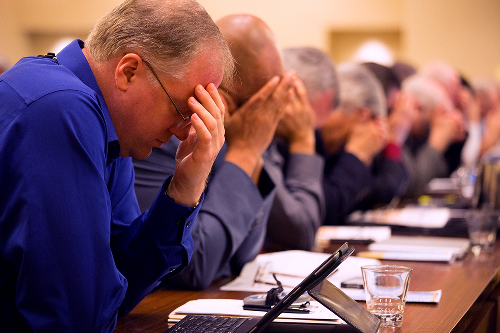 Rick Remmers, president of the Seventh-day Adventist Church in the Chesapeake Region, joins other leaders from throughout North America in prayer. (NAD Communication/Dan Weber)