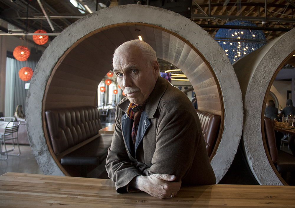 Bernard Hurley poses for a portrait at the RiNo Blue Moon brewery, sited on property he owns.  (Kevin J. Beaty/Denverite)