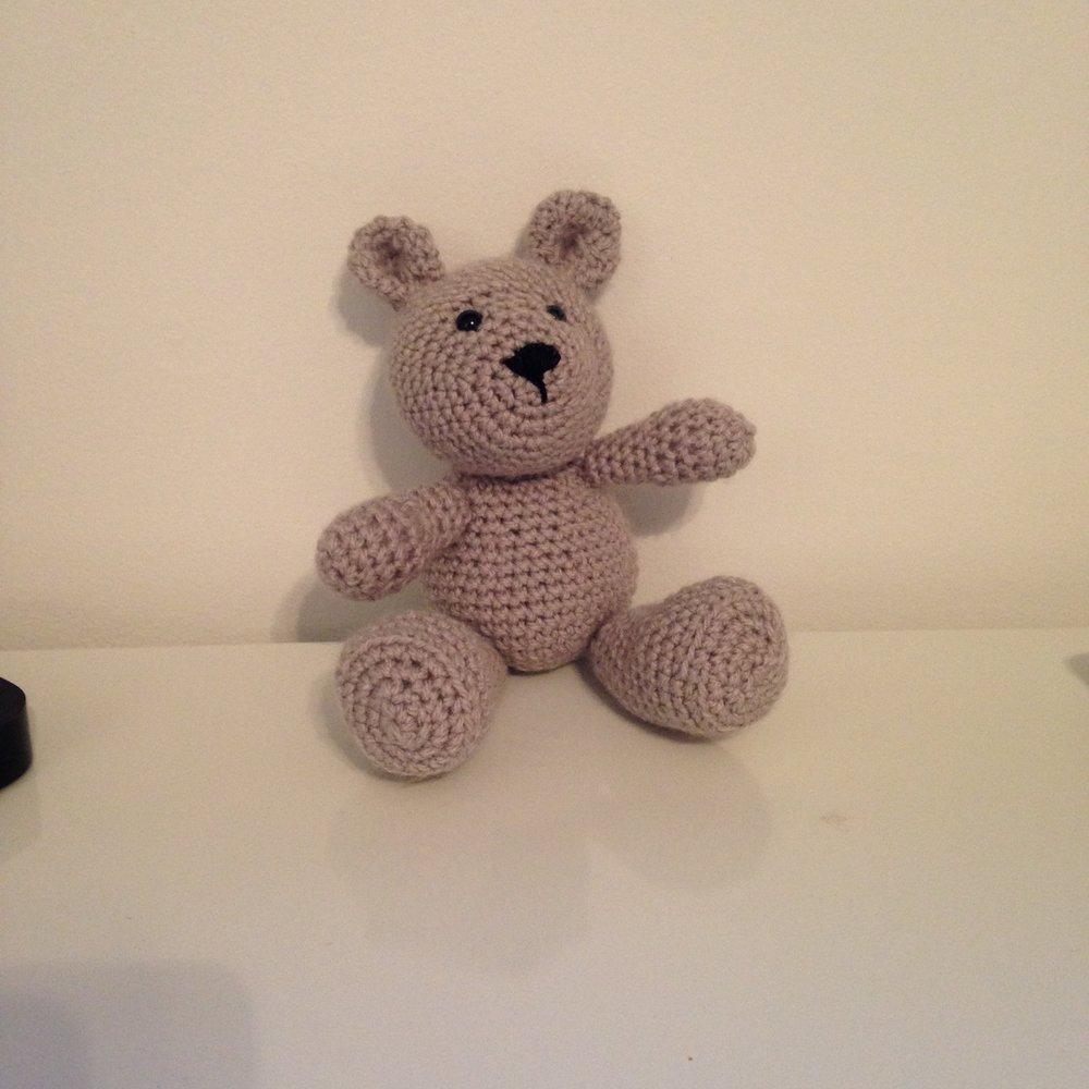 Crocheted teddy bear baby gift