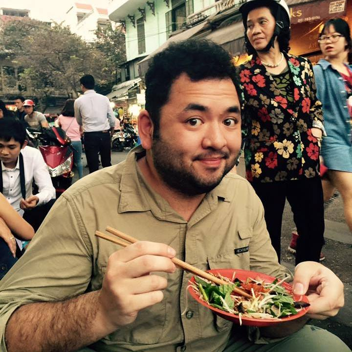 Luis enjoying a fine dining lunch ($1) at a street food stall in Hanoi, Vietnam