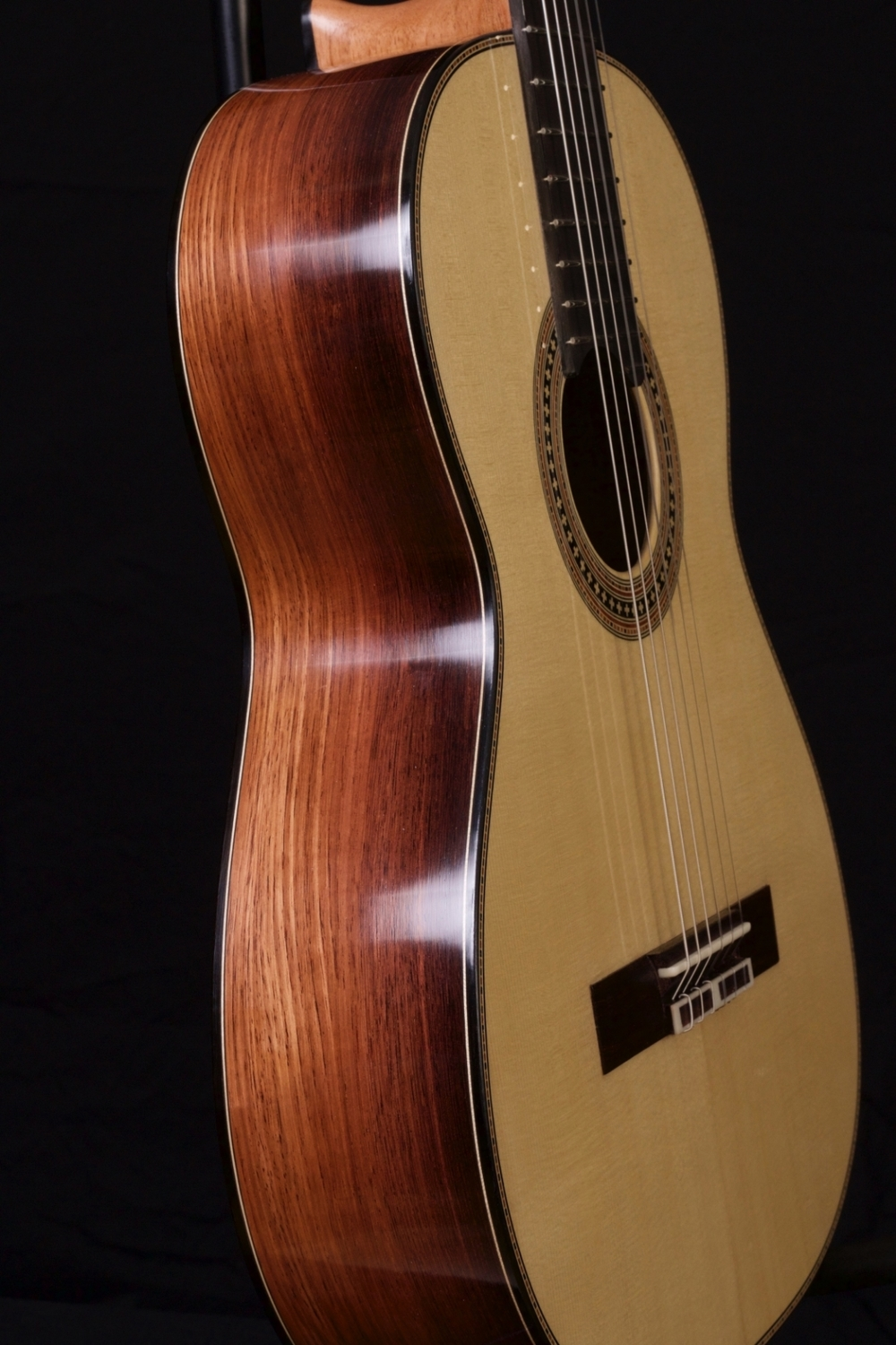 This guitar has a spruce top with Honduran rosewood back and sides. It was sold through the shop of Richard Brune.