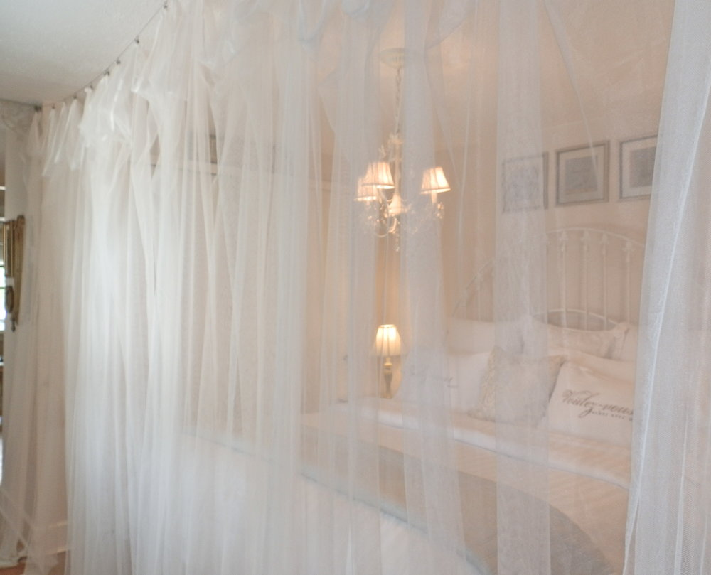 Sleep behind yards and yard of dreamy romantic tulle