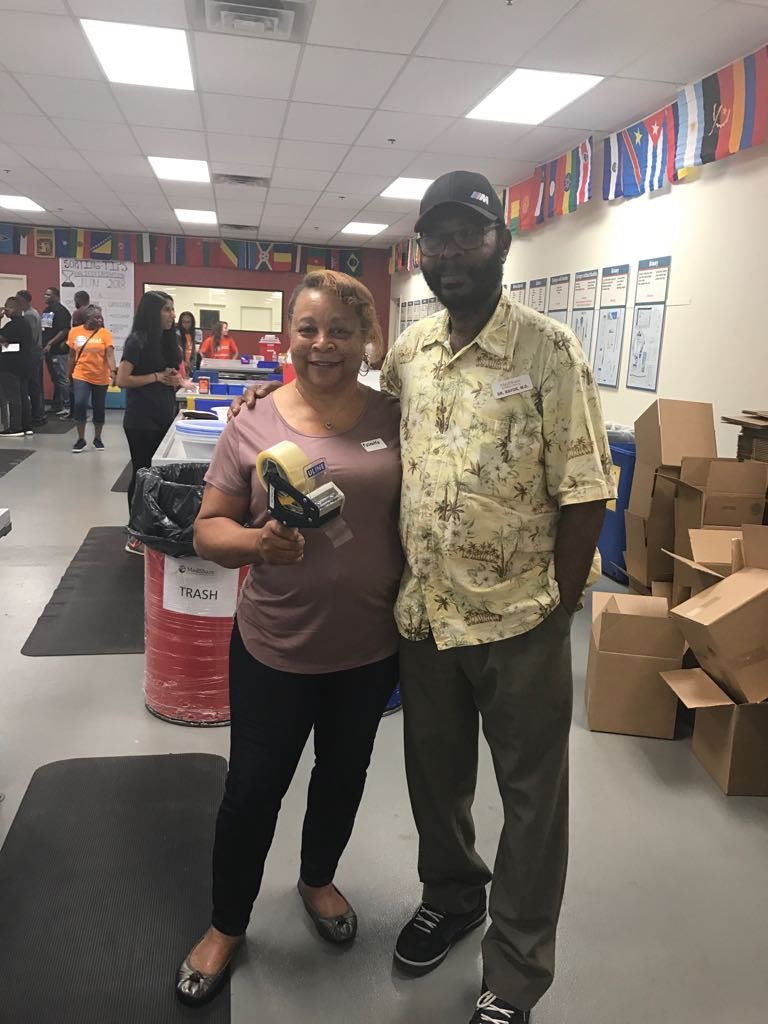 Ms. Jones-Turner with Dr. Moctar Bayor of MedShare's Volunteer Program.