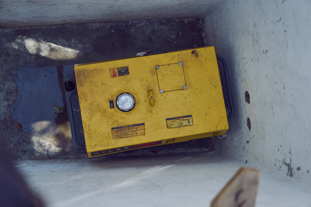 A gasoline generator rendered non-functional after the hurricane.