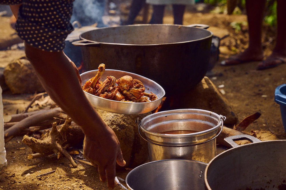 Preparing lunch outside Bethel School, Haiti, 2016.
