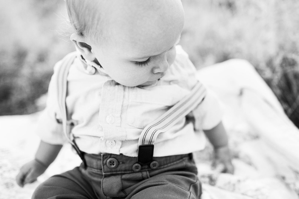 A One Year Old Baby Boy With Suspenders On a Blanket, Amy Wright Photography, Roseville Photographer