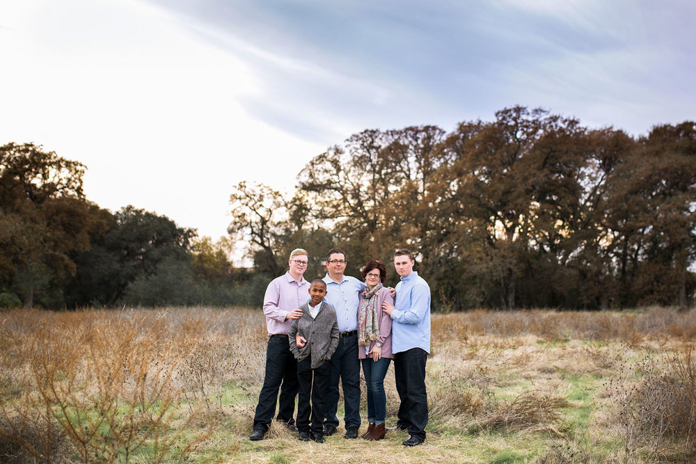 Family of Five standing together in field in Roseville, California