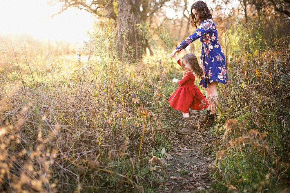 A mother twirls her daughter at a park in Roseville, California.