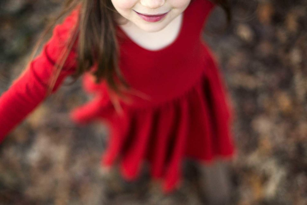 A girl smiles as she twirls in her dress during a photo session in Roseville, California.