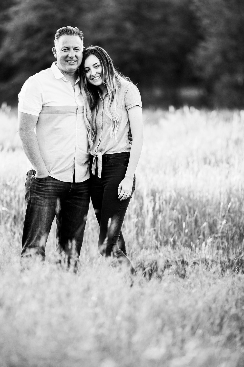 A father and daughter smile for family pictures with Amy Wright Photography in Roseville, California.