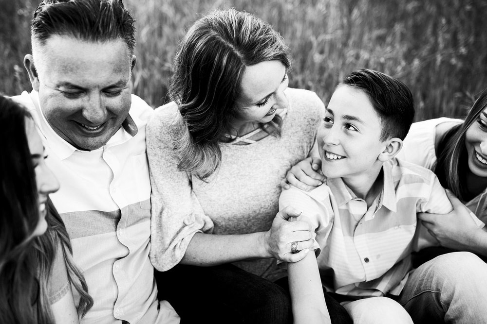 A mother and son exchange loving looks during a family photo session in Sacramento, California.