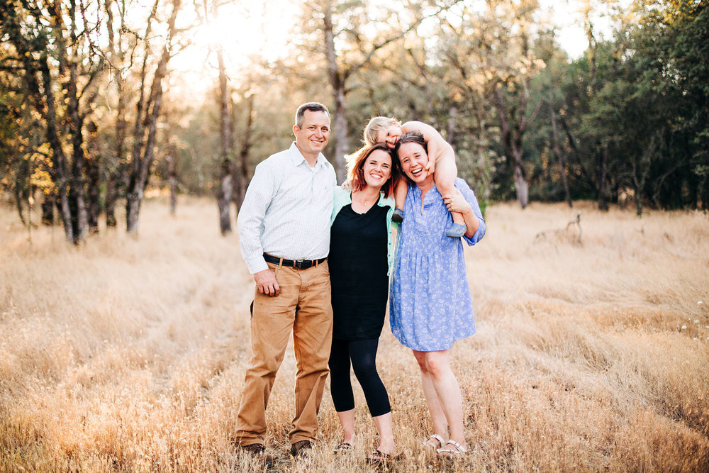 An extended family is happy together during a lifestyle photo session with Amy Wright Photography in Sacramento, California.