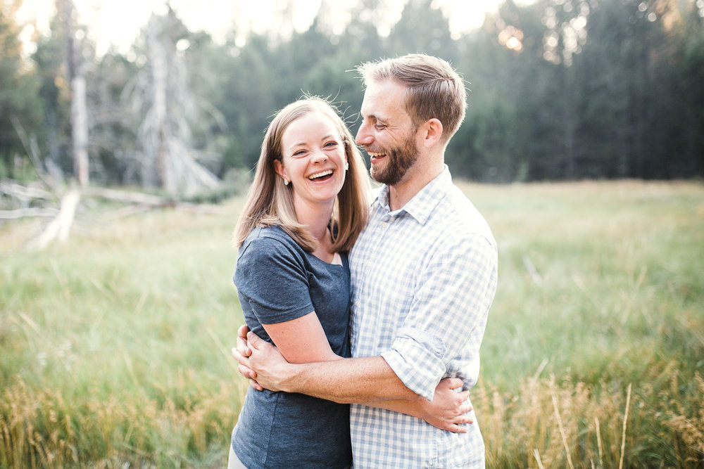A couple laughs and smiles during a family photo session with Amy Wright Photography based out of Roseville, California.