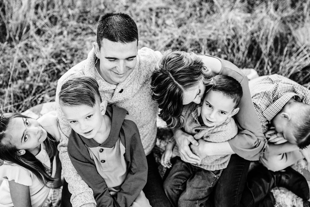 A family enjoys time together during a lifestyle photo session with Amy Wright Photography in Sacramento, California.