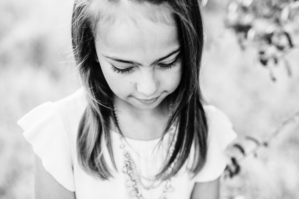 Details are captured of a young girl during a family photo session in Roseville, California with Amy Wright Photography.