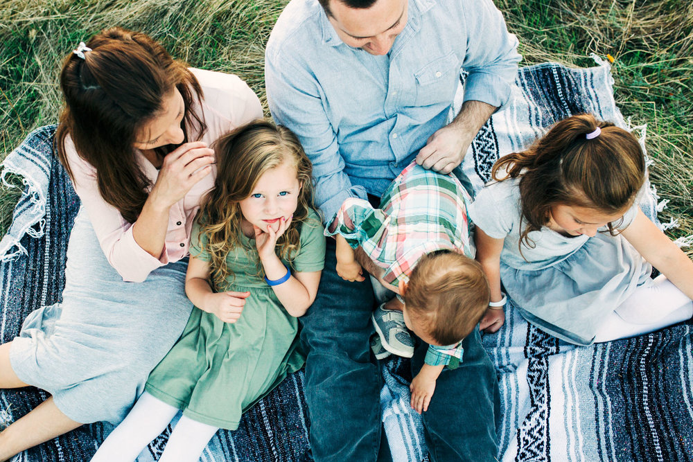 A family spends some time together during a photo shoot in Roseville, California with Amy Wright Photography.