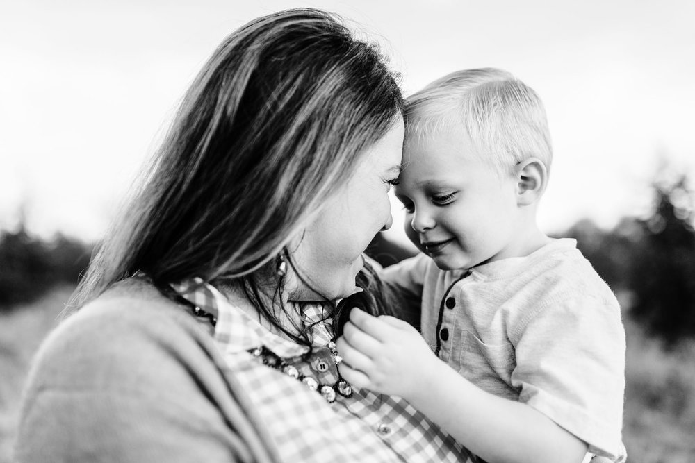A mother and son share a quiet moment as he strokes her hair during a family photo session with their photographer, Amy Wright, in Roseville, California.