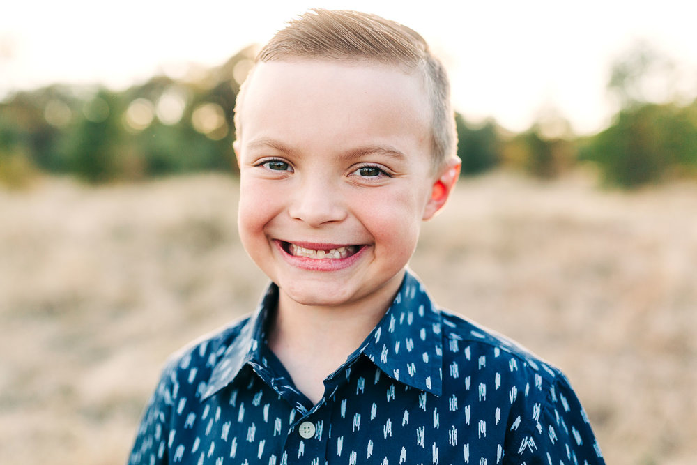 A boy smiles for the camera during family photos with Amy Wright, who is based out of Roseville, California.