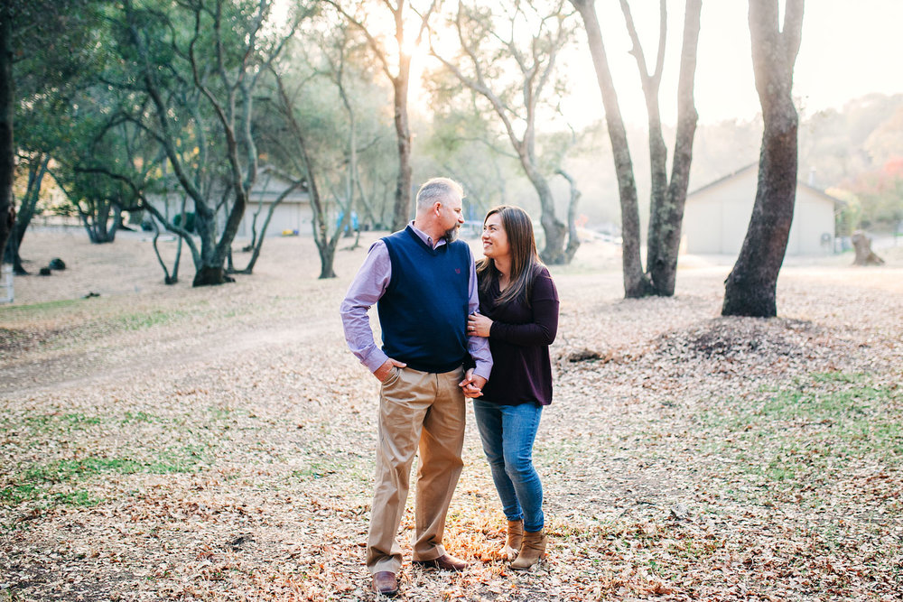 A couple, the mom and dad, happily spend time together during a relaxed family photo session at their home in Granite Bay, California with Amy Wright as their photographer.