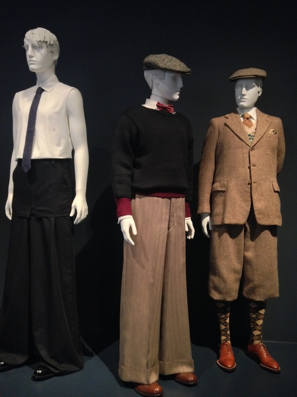 Left to right  Raf Simons, Ensemble, Spring/Summer 2011  Oxford Bags Ensemble, 1928  Suit with Plus-Four knickers. Ropers 'Ltd. 1950