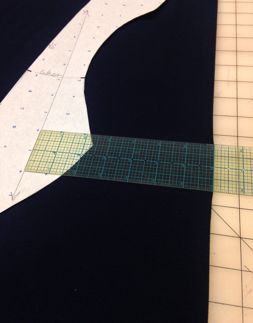Time to trace the pattern onto fabric. I use a ruler to check my straight of grain mark.