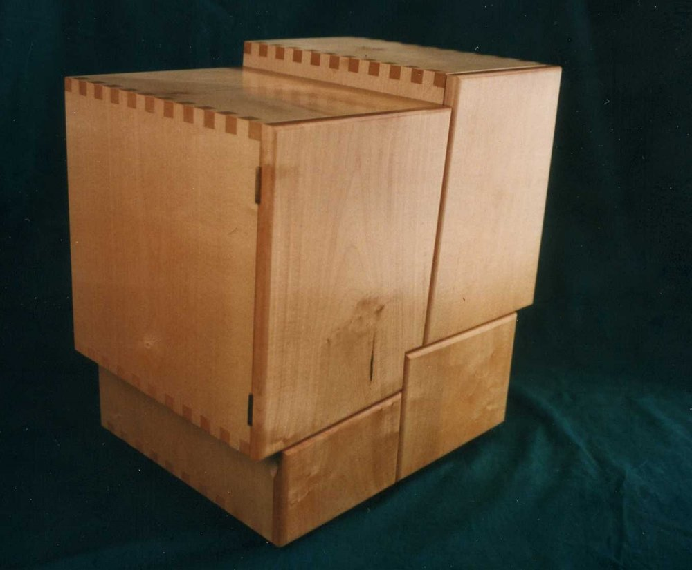 A Cuzco inspired small cabinet. The walls at Cuzco, built by the Incas over 500 years ago intersect at subtle angles, and notch in to each other perfectly. It is still not known how they built them.