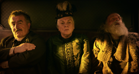 """Tyne Daly (middle) as """"The Lady"""" in """"The Mortal Remains. During an interminable Coen-style ramble delivered by the trapper (played by Chelcie Ross, right), Daly delivers one long reaction shot the whole way through, and she is hilarious. On the right is Saul Rubinek as The Frenchman."""