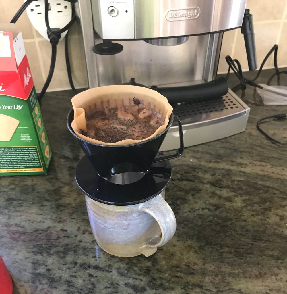 The daily standby. A single-cup cone filter over a handmade mug from another precious friend. Be still, my heart. Note the Delonghi espresso machine in the background, another gift from more precious friends. It seems my friends know me pretty well.