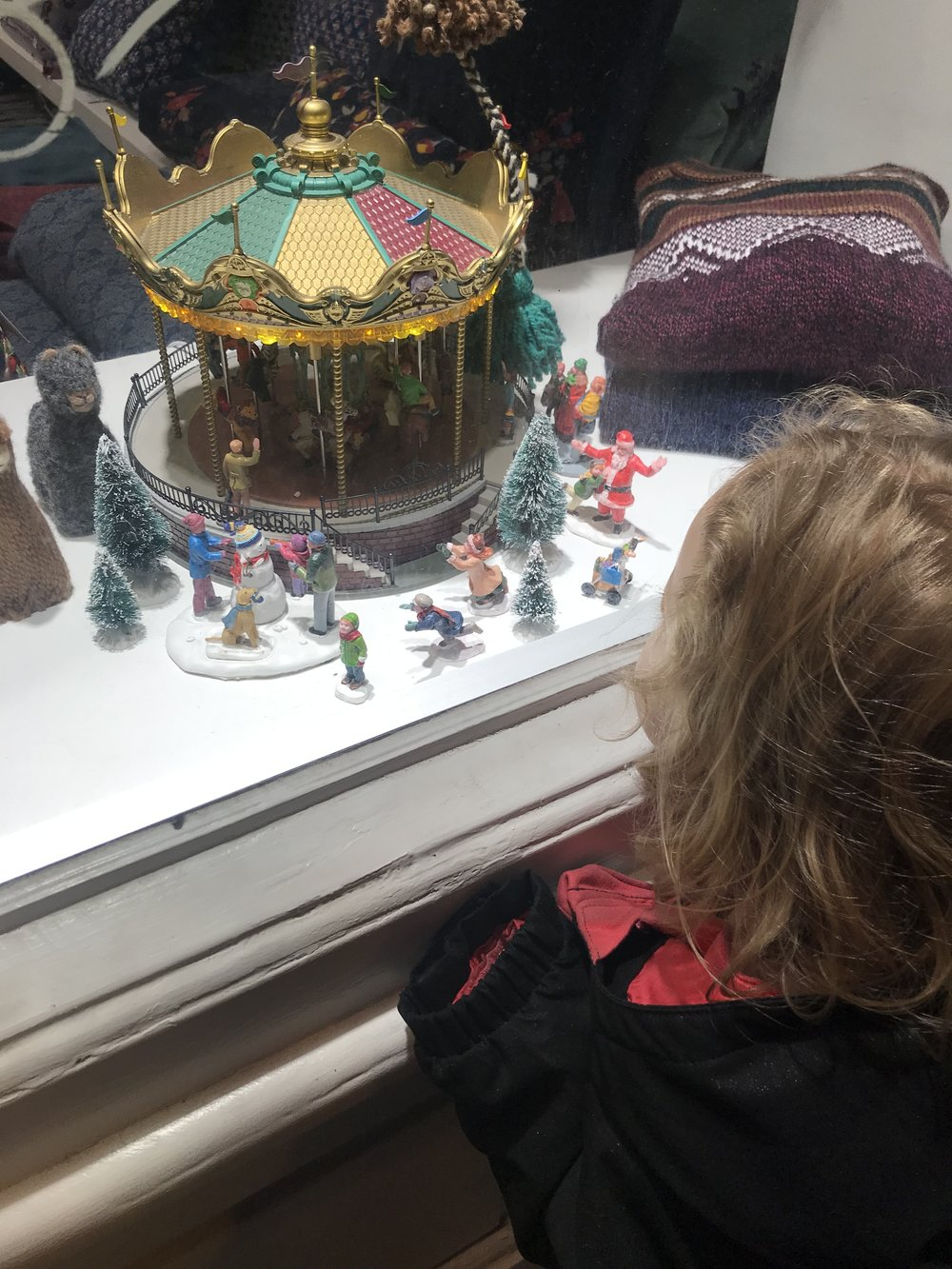 We have visited this window-display carousel several times now, so Ros can live vicariously through all the little teeny people.