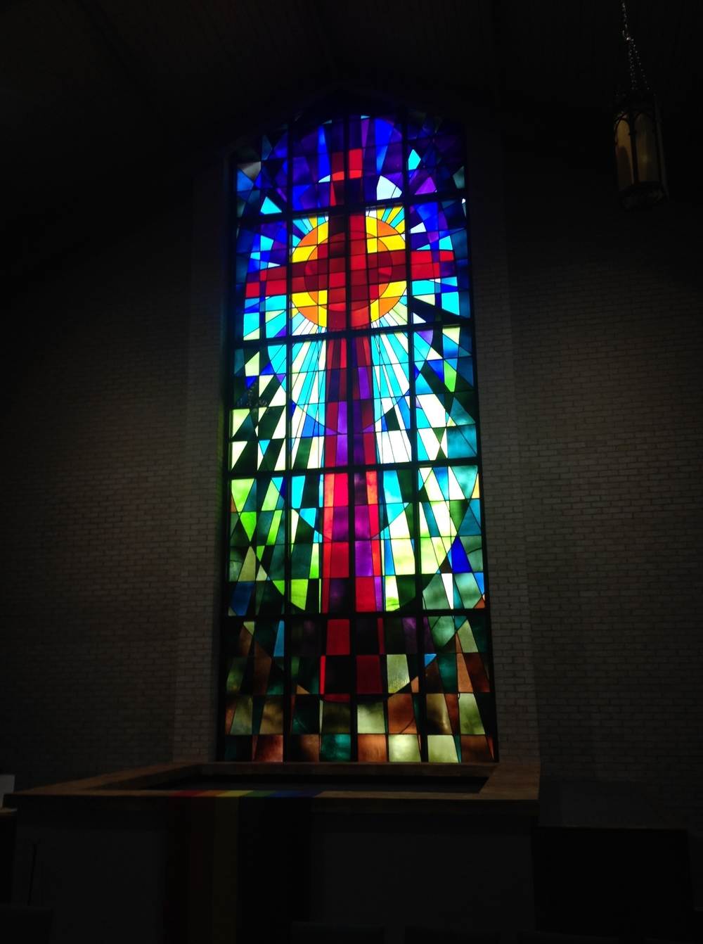 Centerpiece stained glass from Trinity's sanctuary in the round.
