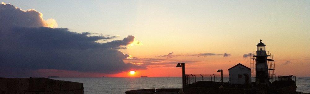 cropped-akko-lighthouse-at-sunset.jpg